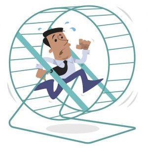 Man running on hamster wheel