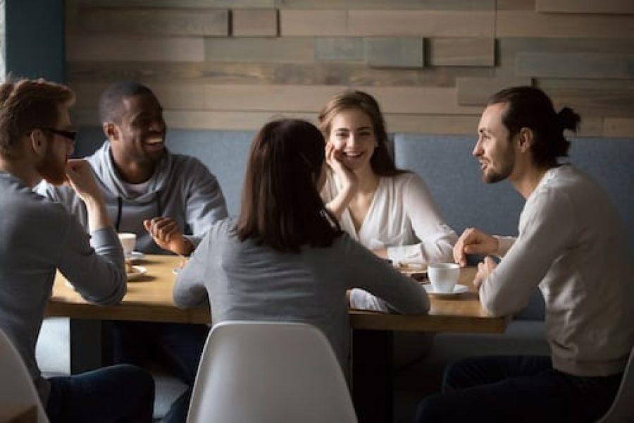 Diverse happy friends having fun sitting in cafe