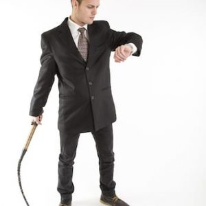 Man in suit with whip